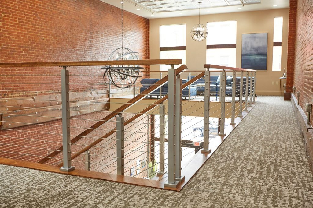 stainless steel cable railing and wooden handrail