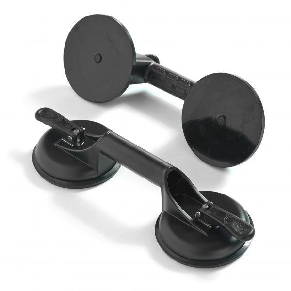 Two suction cups with handles for carrying glass panels
