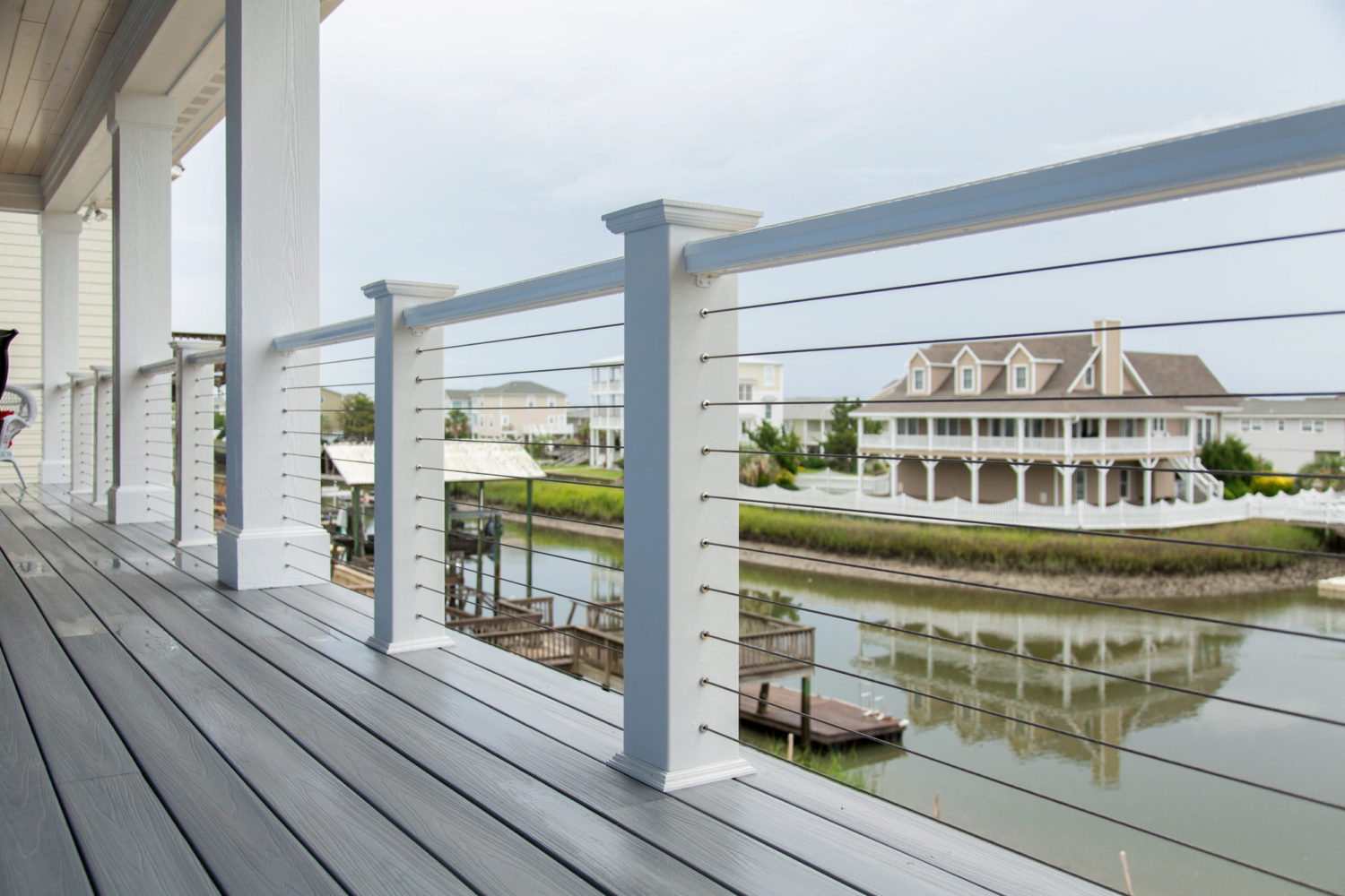 White Exterior Cable Railing Overlooking Pond