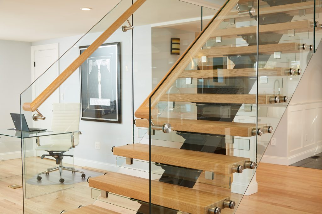 Floating staircase with glass railing in modern home