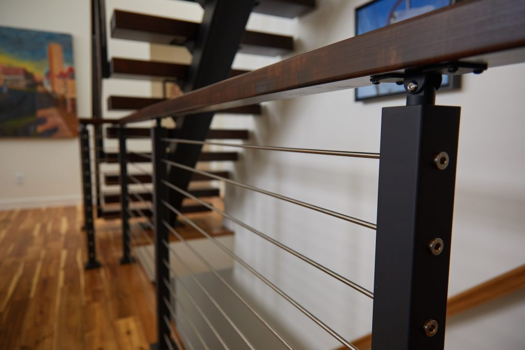 Rod Railing with black railing posts and handrail