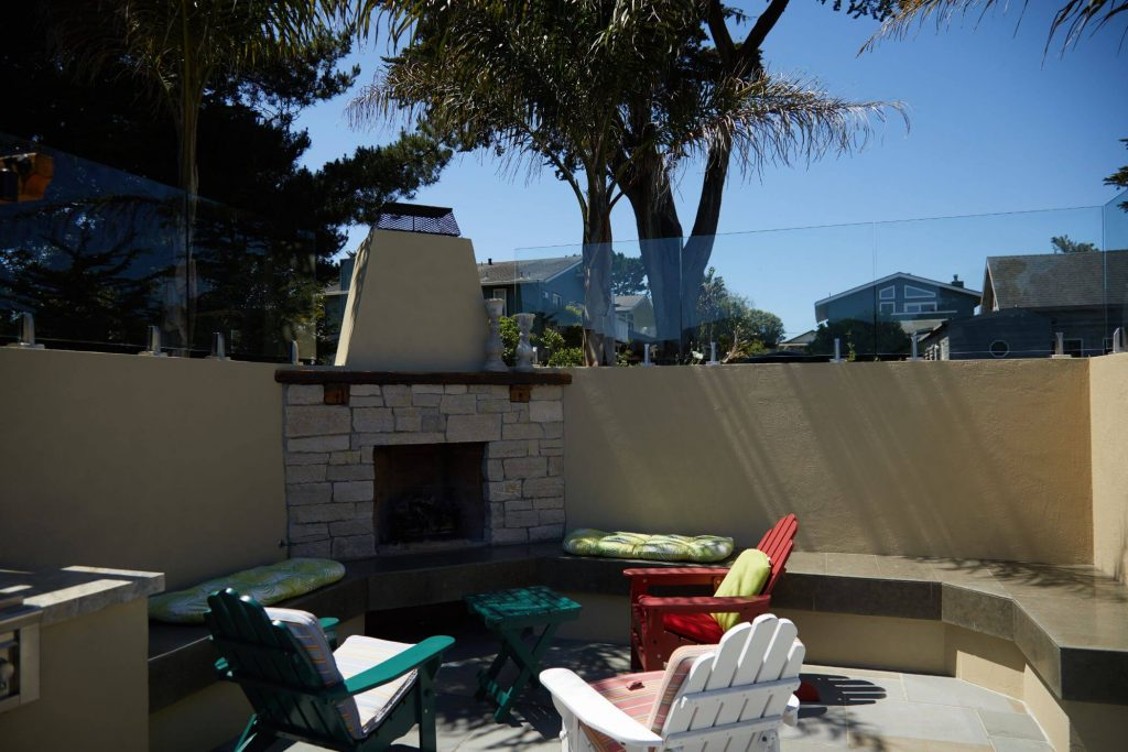 Glass Railing Panels with Outdoor Fireplace