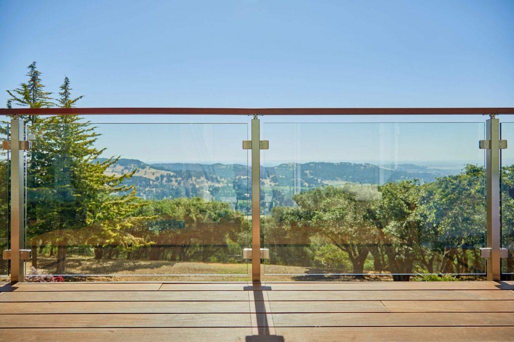 Sleek Wood Handrail with Glass Panels