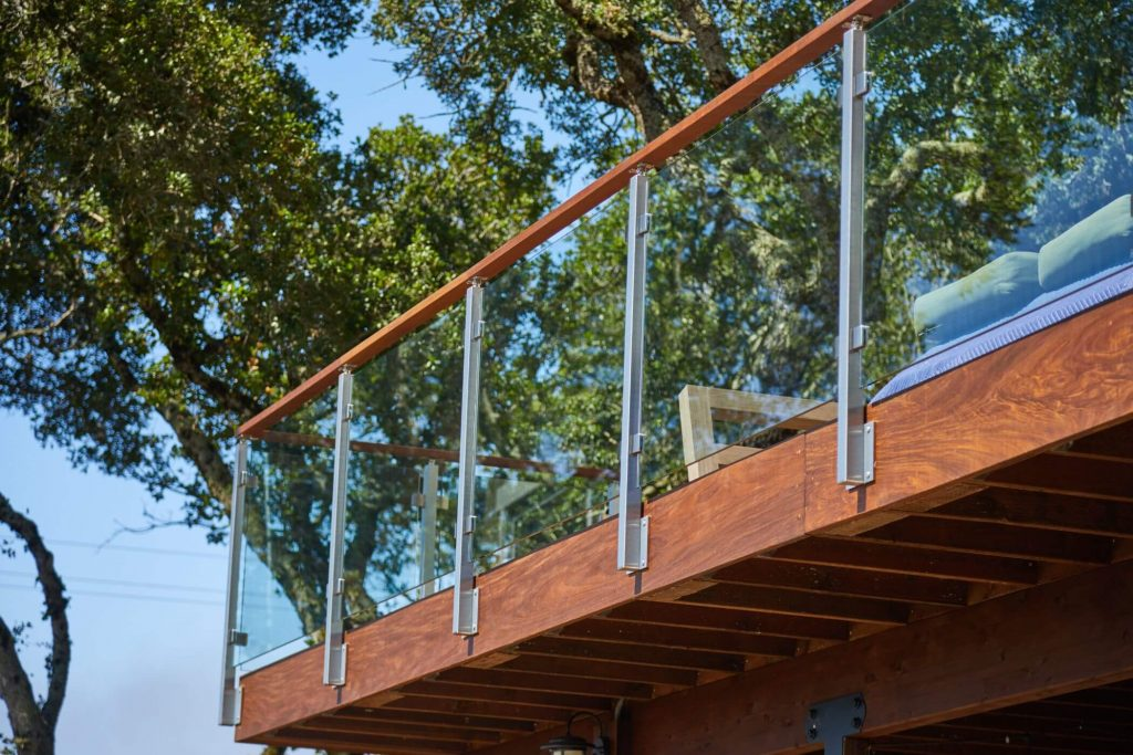 Side Mounted Posts with Glass Railing for Decks