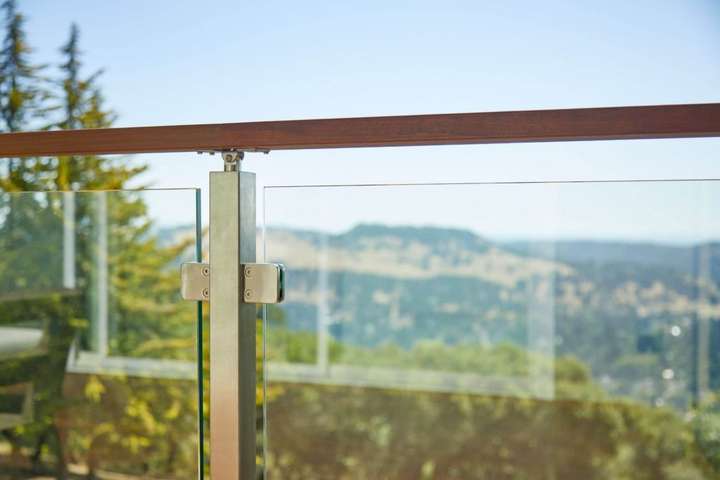 Close Up of Wood Handrail with Glass Panels
