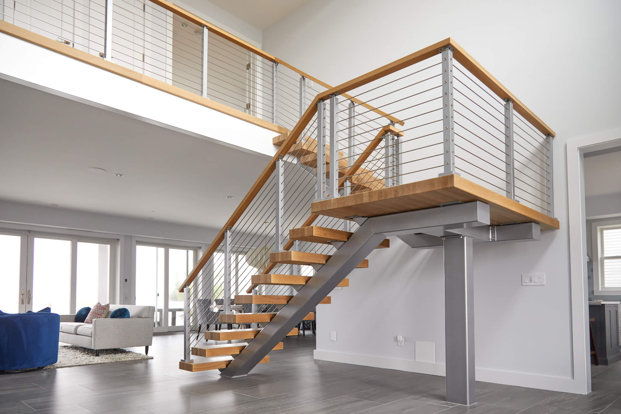 Floating stair treads with wooden handrail