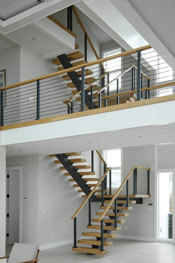 Balcony overlooking floating stairs